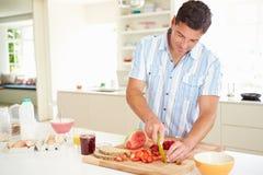 Man Preparing Healthy Breakfast In Kitchen. Cutting Strawberries Stock Photos