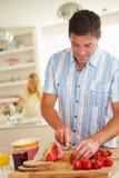 Man Preparing Healthy Breakfast In Kitchen Stock Photo