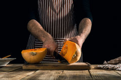 Man preparing healthy food from a pumpkin Royalty Free Stock Images