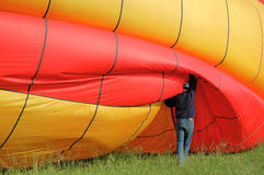 Man preparing hot air baloon for fly #2. Pilot preparing for fly with hot air baloon royalty free stock image