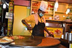 Man Preparing Indian Vegetable Curry Royalty Free Stock Photos