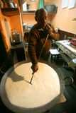 Man preparing kheer at sweetshop, delhi, Stock Photos