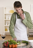 Man Preparing Meal Stock Images