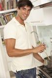 Man Preparing Meal At Cooker Royalty Free Stock Image