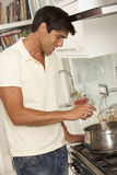Man Preparing Meal At Cooker Stock Photography