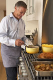 Man Preparing Meal At Home Stock Photography
