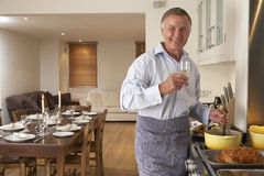 Man Preparing Meal At Home royalty free stock photos