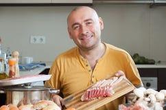 Man preparing meat Stock Image