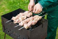 Man preparing meat on the grill Stock Photo