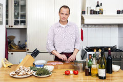 Man Preparing Meat At Kitchen Counter Royalty Free Stock Images