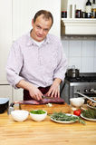 Man Preparing Meat At Kitchen Counter Royalty Free Stock Photos