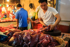 Man Preparing Meat for Sale royalty free stock images