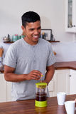 Man preparing morning coffee Royalty Free Stock Images