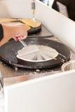 Man preparing pancake stock image