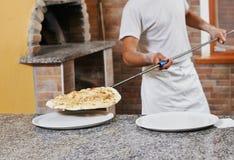 Man preparing pizza Stock Images