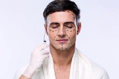 Man preparing for plastic surgery Stock Images