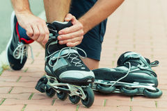 Man preparing for roller blading, Stock Photos