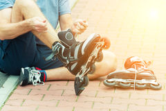 Man preparing for roller blading, Royalty Free Stock Photography