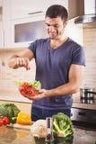 Man preparing salad at home Royalty Free Stock Photography