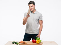 Man preparing salad and winking at camera Stock Photo