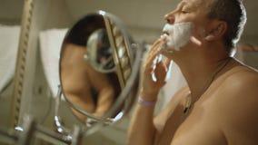Man preparing for shaving stock footage