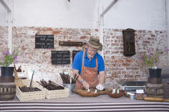 Man Preparing Speciality Sausages Royalty Free Stock Photo