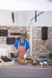 Man Preparing Speciality Sausages At Table Stock Images