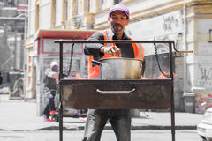 Man preparing street food Stock Image