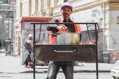 Man preparing street food. VALPARAISO - NOVEMBER 07: Man preparing street food in the districts of the protected UNESCO World Heritage Site of Valparaiso on stock image
