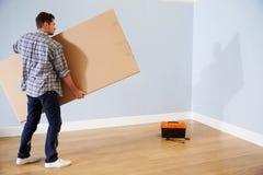 Man Preparing To Assemble Flat Pack Furniture Stock Image