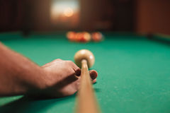 Man preparing to break spheres in billiards. Stock Photos