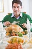 Man Preparing To Carve A Turkey Royalty Free Stock Photos