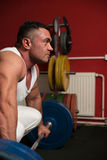 Man preparing to do deadlift Stock Image