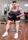 Man preparing to execute gym workout Royalty Free Stock Photos