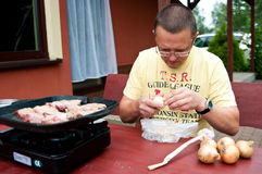 Man preparing to grill food Stock Image