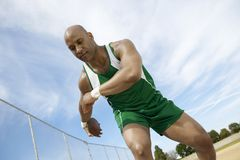 Man Preparing To Throw Discus Stock Photo