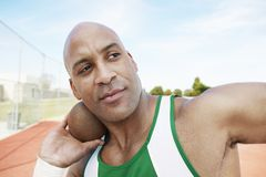 Man Preparing To Toss Shot Put. Close-up of an African American men preparing to toss shot put Royalty Free Stock Photos