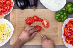 Man preparing vegetables in the kitchen Royalty Free Stock Images