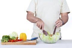 Man preparing vegetables salad Stock Photos