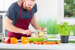 Man preparing food for cooking in kitchen. Man preparing very healthy organic food for cooking in kitchen Stock Images