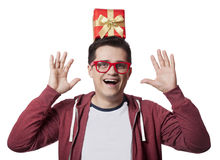 A man with present box on the head, white background. Royalty Free Stock Image