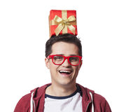 A man with present box on the head, white background. Royalty Free Stock Photography