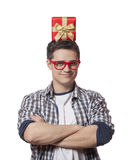 A man with present box on the head, white background. Stock Photo
