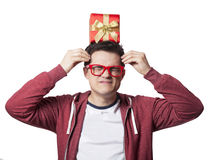 A man with present box on the head, white background. Royalty Free Stock Photo