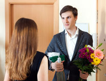 Man present bunch of flowers to his young wife Royalty Free Stock Photo