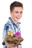 Man present a easter egg in bird nest Royalty Free Stock Photos