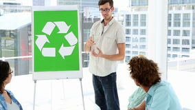 Man present environmental awareness plan to colleagues stock video footage