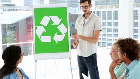 Man present environmental awareness plan to coworkers stock footage
