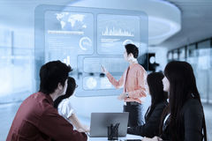 Man presentation with virtual statistics Stock Images