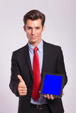 Man presentig tablet and showing thumb up Royalty Free Stock Image